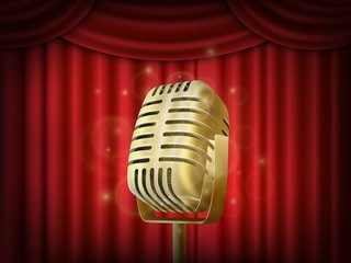 Vintage metal microphone.  Red silk curtain backdrop. Retro mic on empty theatre stage.
