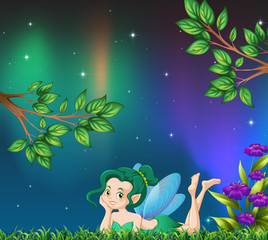 Cute fairy in garden at night