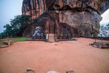 Stairway lion stone paws decorate the gate to Sigiriya Fortress, located on the top platform of the rock, Sri Lanka