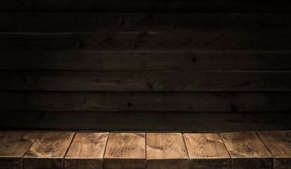 Old wooden tabletop and wooden wall at the background.