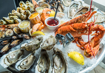 Canvas Prints Seafoods Seafood plate. Different molluscs and crustaceans lay over ice.