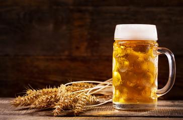 Mug of beer with wheat ears