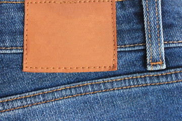 Denim Blue Jeans Empty Leather Label on Back Side. Pair of Classic Modern Style Clothing Blue Jeans. Close Up View of Casual Wear Apparel and Blank Leather Label Tag Copy Space for Template.