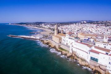 Sitges with a parish churh Sat Bartolome i Santa Tecla. Aerial view.