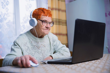 elderly people learn modern gadgets, computer and smartphone