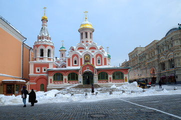 Moscow, Russia - February 8, 2018: The Church in the name of the Kazan Icon of the Mother of God on Red square. People walk on Red square in the winter day