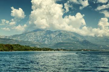 Beautiful mountain landscape cumulus clouds blue sky sea