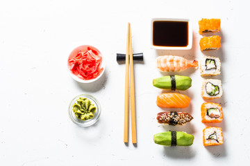 Printed kitchen splashbacks Sushi bar Sushi and sushi roll set on white background.