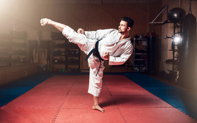 Foto op Aluminium Vechtsport Martial arts, man in white kimono with black belt