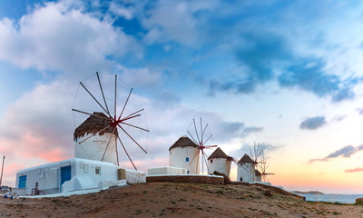 Wall Mural - Famous view, Traditional windmills on the island Mykonos, The island of the winds, at sunrise, Greece