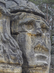 big face devils head sculpted in 19th century by Vaclav Levy to the sand stone rock in Zelizy, czech republic