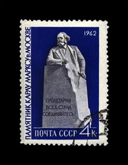 Karl Marx (1818-1883) monument in Moscow, famous politician leader, Capital book author, circa 1962. canceled postal stamp printed in the USSR shows Vintage stamp isolated on black background.