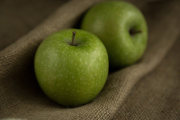 Green apple on a burlap sack