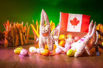 Easter in Canada. Rabbits keep the flag of Canada. The Feast of Easter. Eggs and rabbits.