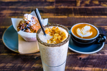 A bright cafe breakfast setting featuring a banana smoothie