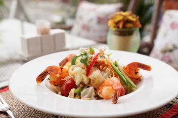 Shrimp appetizer, light summer dish on table oudoors