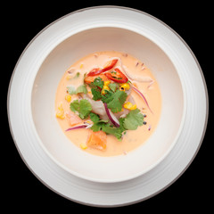 Sea bass ceviche shot from above, isolated on black