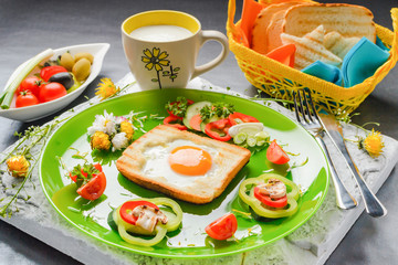 Egg in toast bread baked in the shape of a flower with fresh vegetables and yogurt
