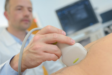 closeup of ultrasound tool on abdomen