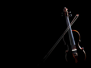 Violin with bow isolated on black