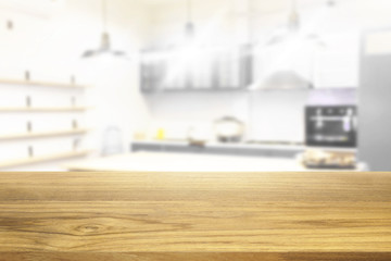 Beautiful empty wooden table and white modern kitchen cafe background
