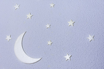 moon with stars on violet rugged background
