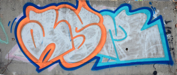 The old wall, painted in color graffiti drawing red aerosol paints. Background image on the theme...