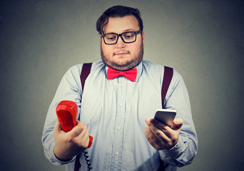 Confused man with old and new phones