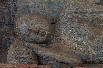 Reclining Buddha statue at Gal Vihara rock temple in the ancient city Polonnaruwa, Sri Lanka