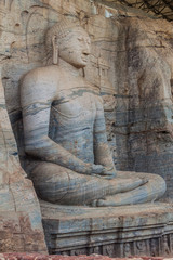 Sitting Buddha statue at Gal Vihara rock temple in the ancient city Polonnaruwa, Sri Lanka