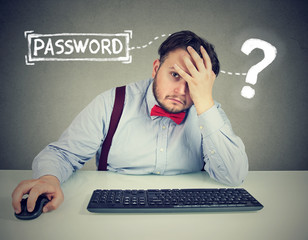 Desperate man trying to log into his computer forgot password