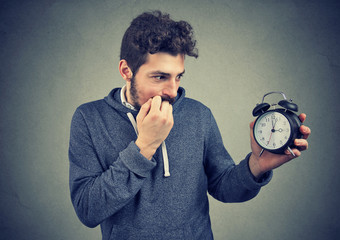 Man being anxious about time pressure