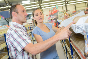 Couple choosing product in hardware store