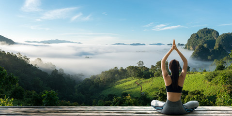 Foto op Plexiglas School de yoga Young woman practicing yoga in the nature