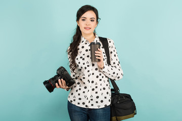 Young woman with camera and coffee