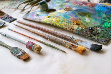 Set of artistic brushes, palette and paints.