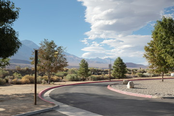 parking bay turning point in scenic idyle in nevada usa road trip vacation with a beautiful view to landscape to rest. cartoon look, picturesque colors. empty street turn with quiet rest area
