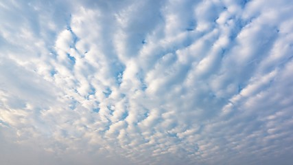 Sky full with stratocumulus clouds background