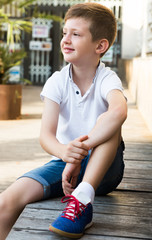 boy sitting outdoor