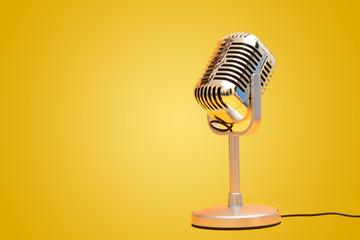 Retro vintage microphone on yellow background studio