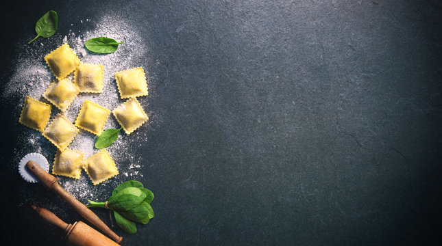 Ravioli with spinach and ricotta on dark background