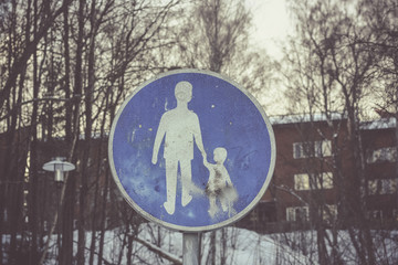 Walkway traffic sign with a man and child holding hands. The child graphic is damaged and abused, concept of violence, kidnap, child abuse..