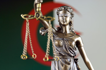 Symbol of law and justice with Algeria Flag. Close up.