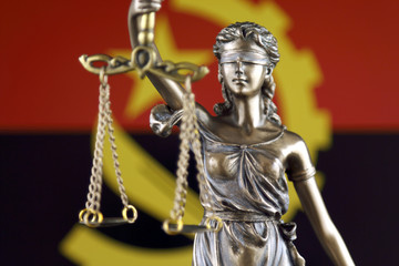 Symbol of law and justice with Angola Flag. Close up.