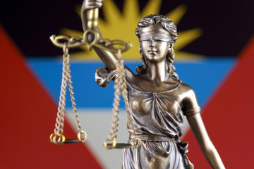 Symbol of law and justice with Antigua and Barbuda Flag. Close up.