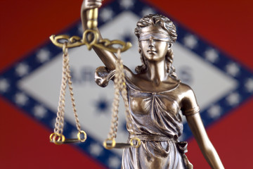 Symbol of law and justice with Arkansas State Flag. Close up.