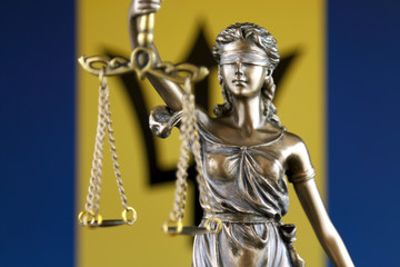 Symbol of law and justice with Barbados Flag. Close up.