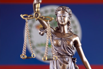 Symbol of law and justice with Belize Flag. Close up.