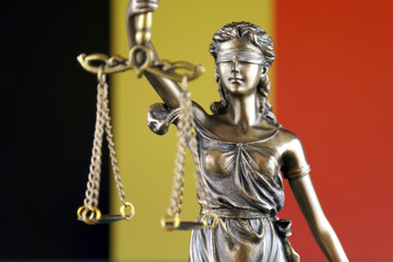 Symbol of law and justice with Belgium Flag. Close up.