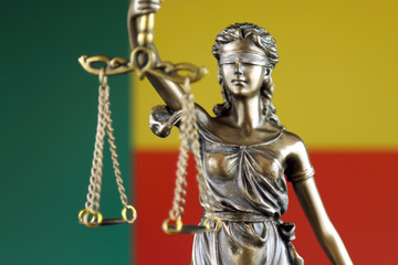 Symbol of law and justice with Benin Flag. Close up.